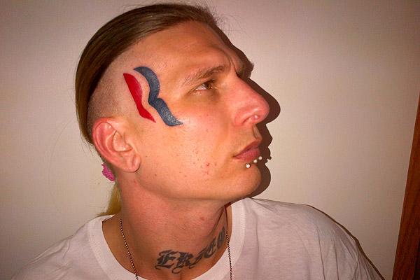 Pro Wrestler Tatooes Romney's Log on his Face