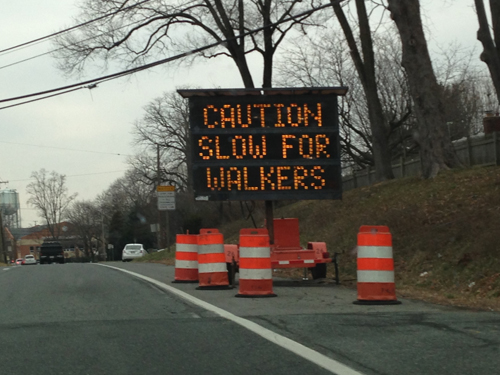 CAUTION SLOW FOR WALKERS