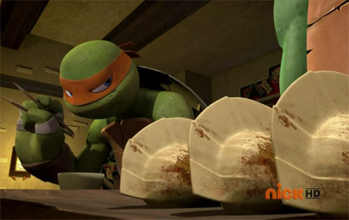 Michelangelo steals Leo's pizza gyoza.
