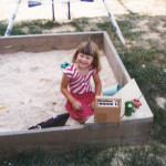 In the sandbox with my Fisher Price Tape Recorder